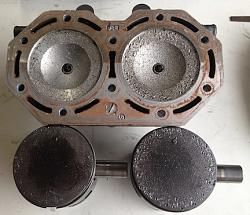 2 cycle combustion chamber repair-1-damaged-headpistons.jpg