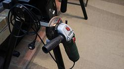 Angle grinder holder to my miter saw stand.-3.jpg