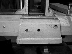 Band Saw Out Feed Table-10-two-holes-drilled-saw.jpeg