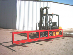 extra wide fork lift forks for carrying very long materials-swivel-fork-carriage1.png