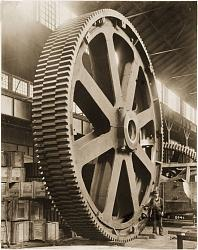 High-quality black-and-white photographs of large old machines and tools-huge-cog.jpg