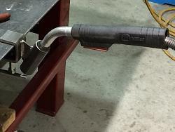 Welding with some spare metal-mig-gun-holder.jpg