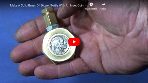 Brass Oil Dipper With Inset Coin
