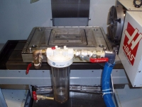 Vacuum Table Coolant Trap