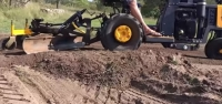 Tractor and Soil Scraper